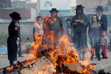 Ultra-Orthodox Jews burn leaven in the Mea Shearim neighbourhood of Jerusalem ahead of the Jewish holiday of Passover, in Jerusalem
