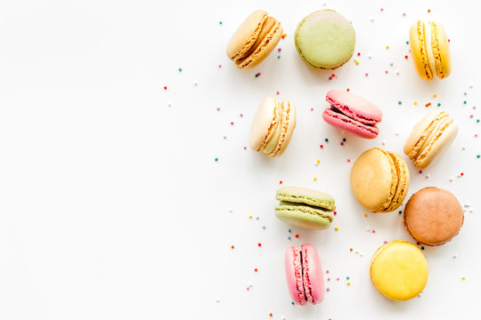 Macarons design on white background top view space for text