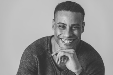 Fashion portrait of Attractive african american male model posing happy and sexy for the camera