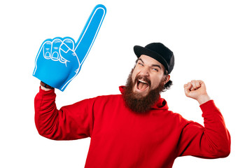 Young bearded manhaving an exciting face with foam blue number one hand on white background.