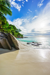 Paradise tropical beach with rocks,palm trees and turquoise water in sunshine, seychelles 4