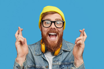Excited hipster wishing to win lottery Wall mural