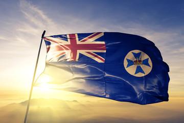 Fototapeta Queensland state of Australia flag waving on the top sunrise mist fog obraz