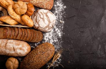Assortment of baked goods on dark background