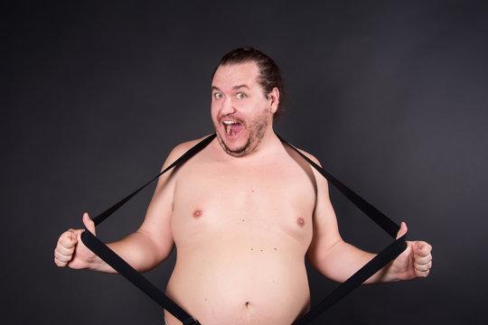 Funny fat man. Black background.