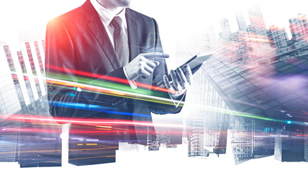 Businessman with tablet in abstract city