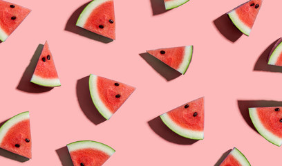 Sliced watermelons arranged on a pink background Wall mural