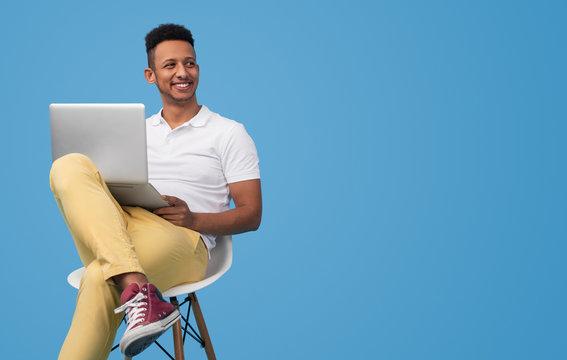 Modern student using laptop near empty space