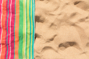 Beach towel on sandy tropical beach