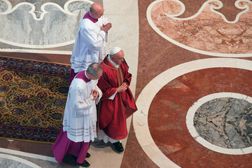Pope Francis gets back up after lying on the ground to pray during the Celebration of the Lord's Passion on Good Friday in Saint Peter's Basilica at the Vatican