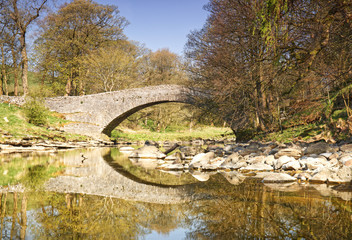Bridge over the River Ribble with reflection
