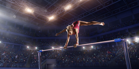 Female athlete doing a complicated exciting trick on horizontal gymnastics bars in a professional gym. Girl perform stunt in bright sports clothes