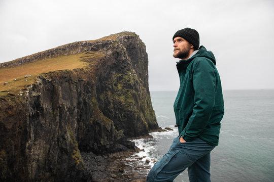 Hiker at Neist Point, Skye, Scotland, UK