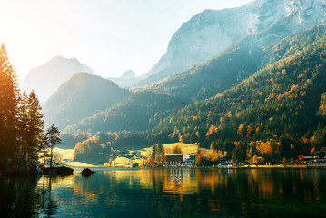 Alps, lake Hintersee in the morning, Majestic German Alps mountains under sunlight on a sunny day. Scenic view of the silent lake Hintersee in Ramsau, Germany. Popular location for photographers. Wall mural