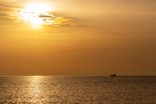 Golden summer Adriatic Sea sunrise with a ship at Senigallia, Province of Ancona, Marche, Italy