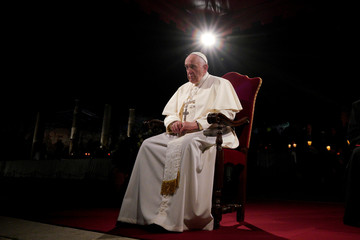 Pope Francis presides over the Via Crucis (Way of the Cross) torchlight procession on Good Friday, in front of Rome's Colosseum, in Rome