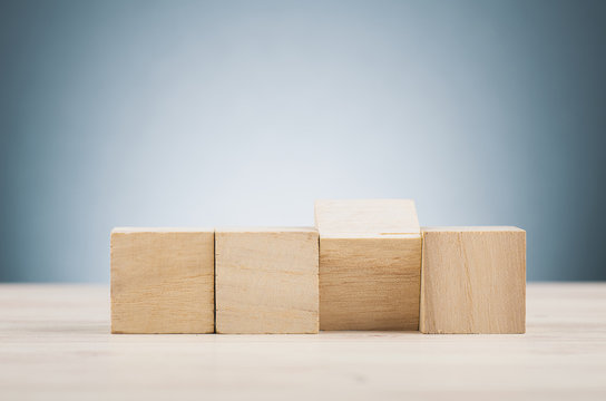 wooden cube on desk over beautiful reverberation gradient background