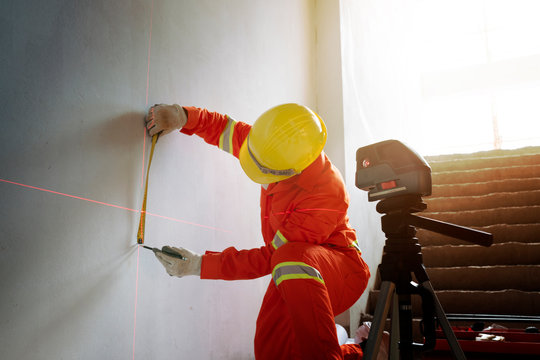 Technician with Laser measurement level during work