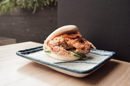 Deep-fried soft shell crab bun with kimchi.