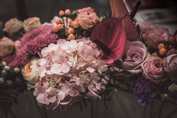 Flower arrangement of different colors. The photo is processed in vintage style, toning and light blur. Fototapete