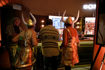 Concertgoers wearing costumes wait at the bar before the Lebowski Fest concert at The Wiltern theatre in Los Angeles