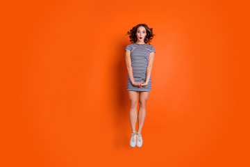 Wall Mural - Full length size photo of slim attractive pretty cool hipster she her lady jumping up in straight position wearing canvas footwear isolated vivid vibrant background