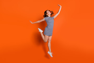 Full length body size photo picture of optimistic charming gorgeous nice cute lovely sweet she her lady ballerina showing movement raising hands up isolated vivid background