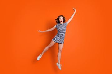 Wall Mural - Full length size body photo picture of humorous laughing charming cute lovely with open mouth she her people person falling down wearing white footwear shoes isolated vivid background