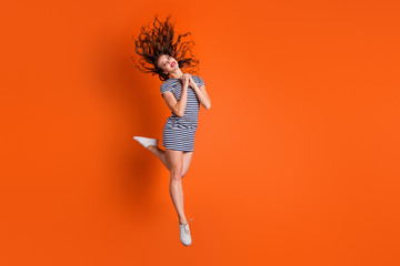 Wall Mural - Full size length body photo of slim tender gentle romantic lovely sweet she her hipster lady with blowing hairdo having funky free time isolated bright vivid background