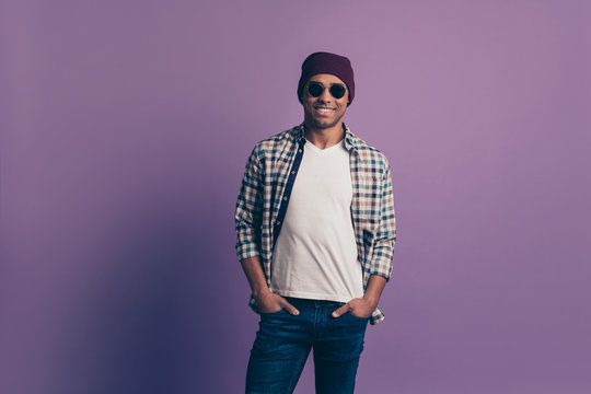 Photo portrait of confident nice attractive virile masculine cheerful with teeth smile guy holding putting hands into the pockets isolated violet background