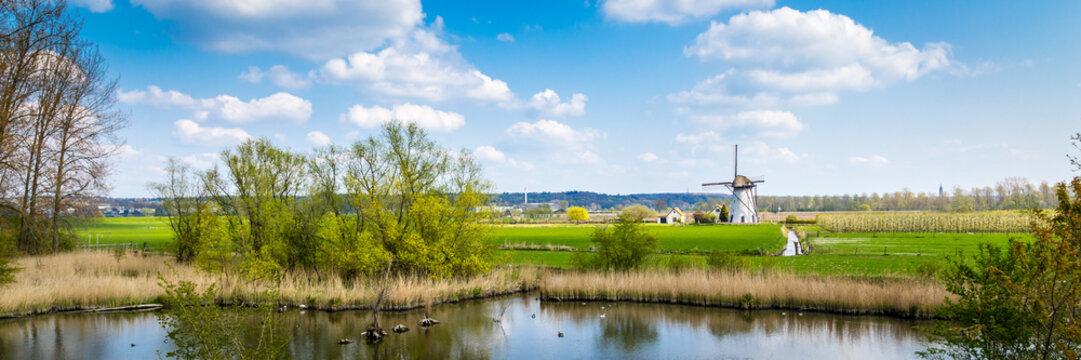 White Dutch windmill near Kesteren in Gelderland in the Netherland