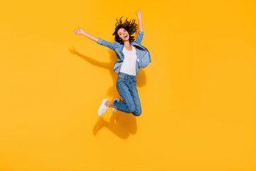 Wall Mural - Full length body size view photo playful childish cute lady move holidays glad laughter raise hands travel summer candid freedom active energetic denim suit sneakers legs isolated vibrant background