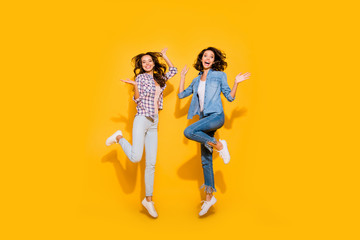 Wall Mural - Full length body size view photo charming nice teens teenagers weekend free time holidays good summer content rejoice raise palms hands fool travel laugh jeans plaid outfit isolated yellow background