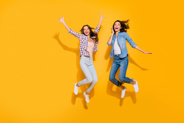 Wall Mural - Full length body size view photo lovely fellows fellowship satisfied glad free time weekends travel beautiful spring summer raise hands arms scream shout checked shirt isolated yellow background