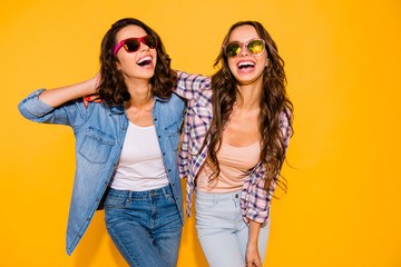 Portrait beautiful cute charming teen teenagers satisfied content chill laughter touch hair free time weekends summer travel holidays spring dressed checked shirt denim isolated yellow background Wall mural