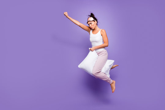 Full length side profile body size photo beautiful she her lady super power flight hold between legs pillow funny satisfied wear sleeping mask pants tank-top pajamas isolated violet purple background