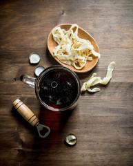 Beer in a mug and squid rings in a bowl.