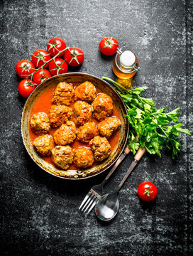 Meat balls with herbs and tomatoes.
