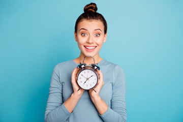 Close-up portrait of her she nice-looking attractive winsome lovely cheerful cheery funny girl holding in hands retro vintage clock isolated over bright vivid shine turquoise background Fototapete