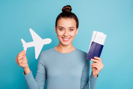 Close up photo beautiful amazing she her lady hands arms hold paper airplane go abroad parents first time show transport passport tickets wear casual sweater pullover isolated blue bright background