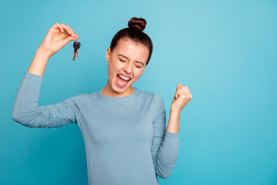 Portrait of delighted lady luck lucky triumph raise fists close eyes content rejoice scream shout yeah mover move in settlement loan beautiful bun trendy stylish sweater isolated on blue background
