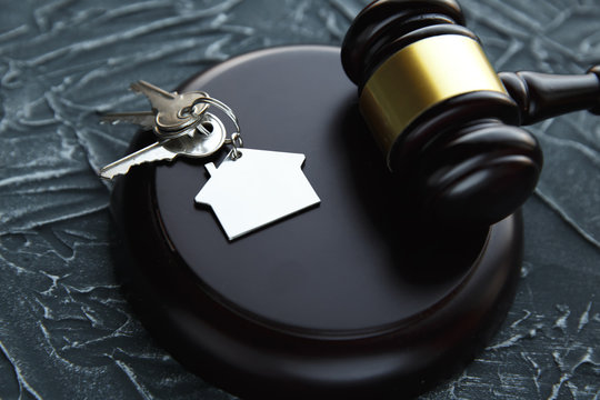 Gavel wooden and house for home buying or selling of bidding or lawyer of home real estate and building concept.