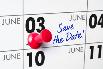 Wall calendar with a red pin - June 03