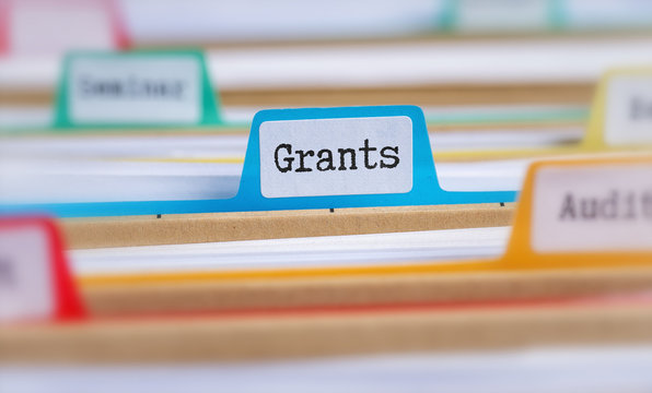 File folders with a tab labeled Grants