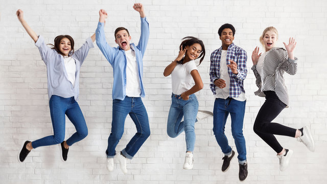 Happy students jumping on white background, passed exams