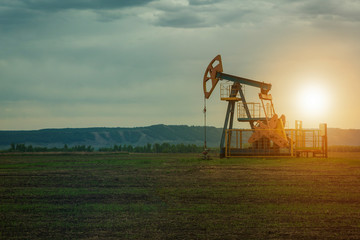 oil pump on the background of nature. the landscape of oil production. oil market.