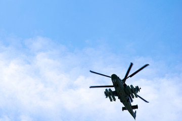 Garden Poster Helicopter Russian military combat attack helicopter K-52 Alligator flies against a blue sky and clouds