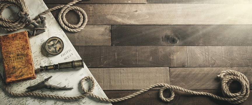 Vintage Nautical Travel Instruments With Rope And Anchor On Wooden Ship Deck Background - Travel / Leadership Concept