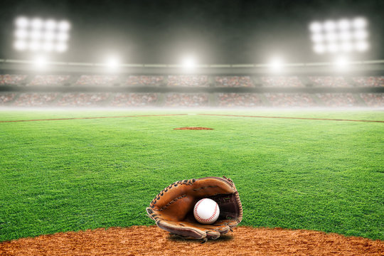 Baseball Glove on Field in Outdoor Stadium With Copy Space