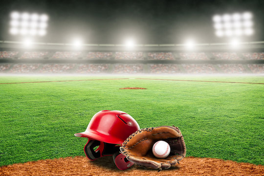 Baseball Glove, Ball, and Helmet on Field in Outdoor Stadium With Copy Space